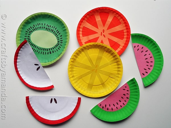 Paper plates painted as cut fruit.