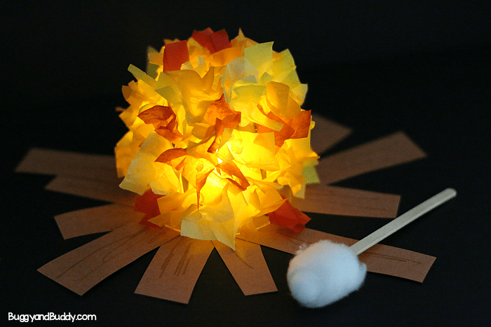 Cute campfire craft made from tissue paper and a jar with a roasting marshmallow made from s popsicle stick and cotton ball.