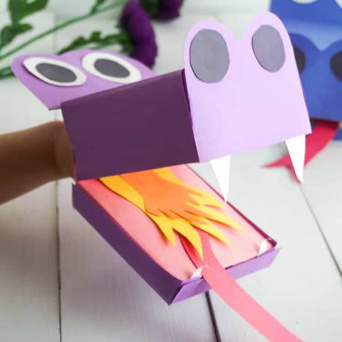 Cute dragon puppets cut out of construction paper with fiery tongues..