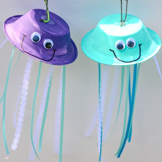 Paper bowls and ribbon made into hanging jellyfish crafts.