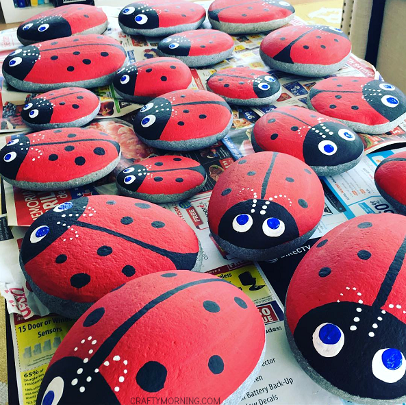 Large rocks painted as ladybugs.