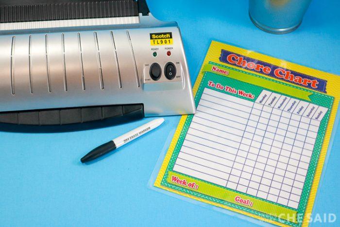 Laminated chore chart, dry erase marker and laminator