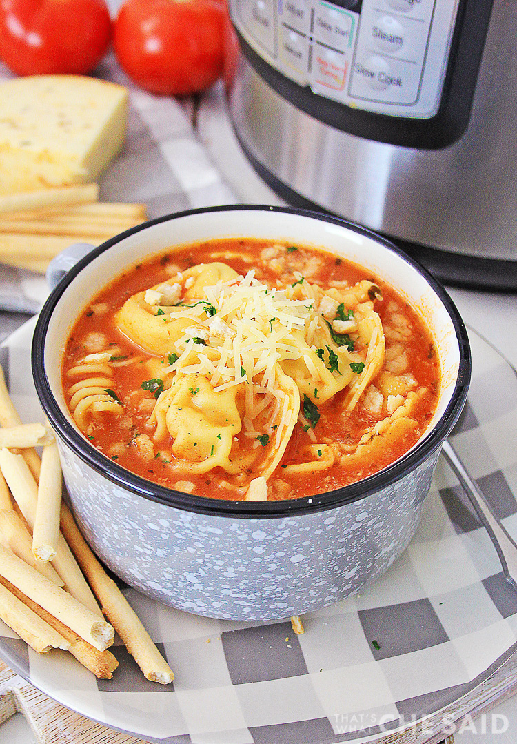 Chicken Parm Soup in front of the Instant pot and a few ingredients
