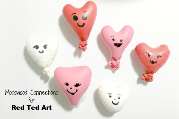 Filled heart balloons with faces for fidgets.