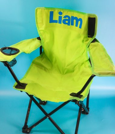 Personalized camp chair. green chair with name on it in blue iron on