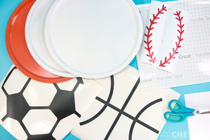 Supplies for Sports Magnet Boards, painted pizza pans, vinyl, transfer tape, scissors and hook and scraper