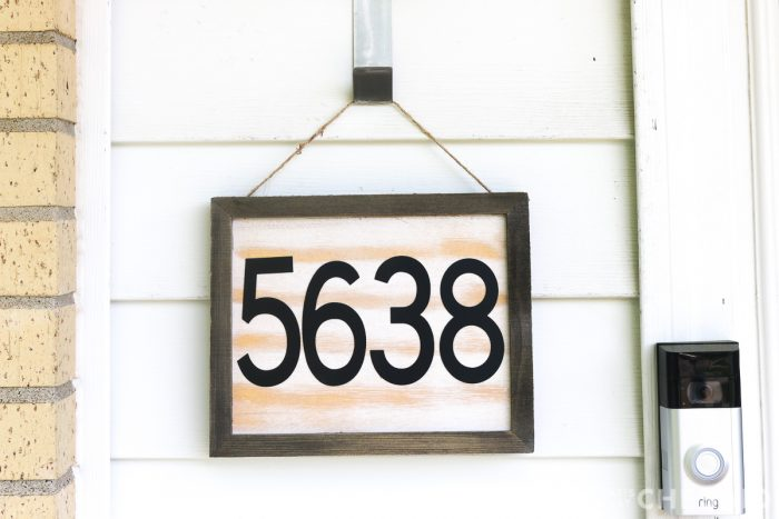 DIY House number sign hanging next to front door - close up