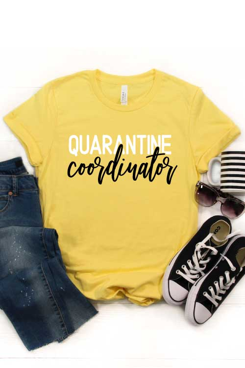 "Yellow shirt with ""Quarantine Coordinator"" in iron on with jeans, converse coffee mug and sunglasses - Vertical"