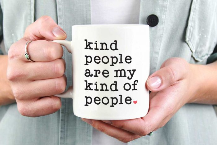 "Woman holding White Coffee Mug with Saying ""Kind People are My Kind of People"" in Vinyl - Horizontal"
