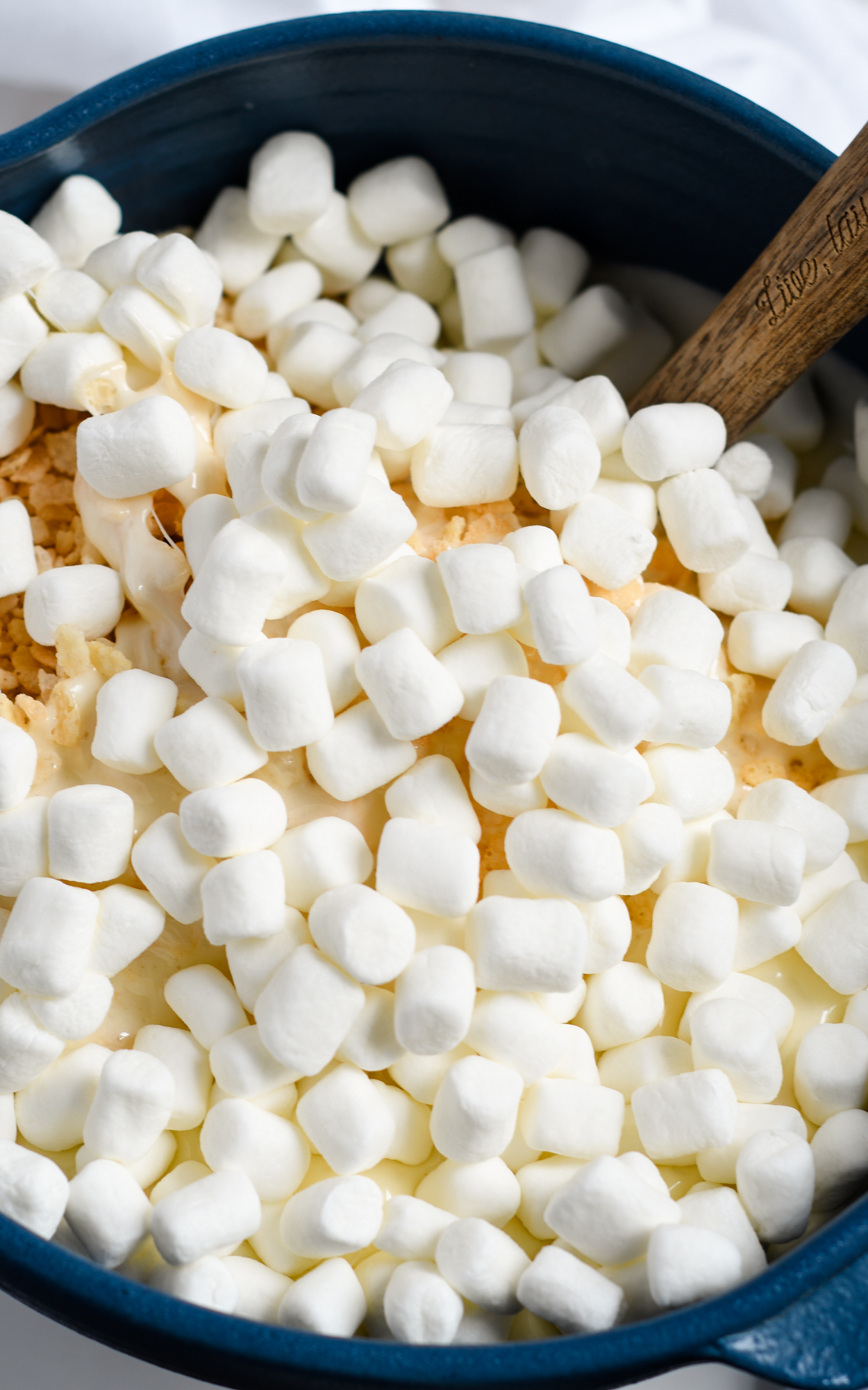 Adding marshmallows to Krispie Mixture