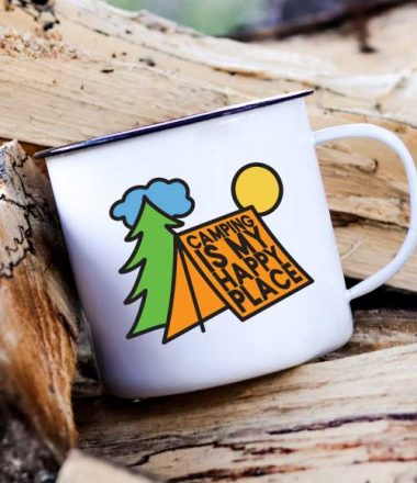 Camp Mug on a stack of wood with Camping is My Happy Place SVG in vinyl - Vertical