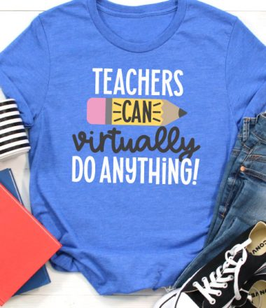 "Blue T-shirt with jeans, converse, a coffee mug and folders that has the SVG File ""Teachers Can Virtually Do Anything"" in iron on in vertical orientation"