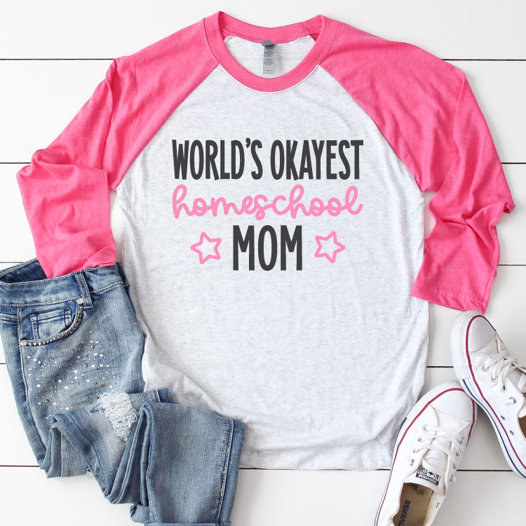"White Raglan T-shirt with Pink sleeves and jeans and sneakrs. Shirt reads ""World's Okayest Homeschool Mom"" in iron on vinyl - Square Format"