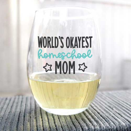 """Wine Glass with """"World's Okayest Homeschool Mom"""" applied with adhesive vinyl"""