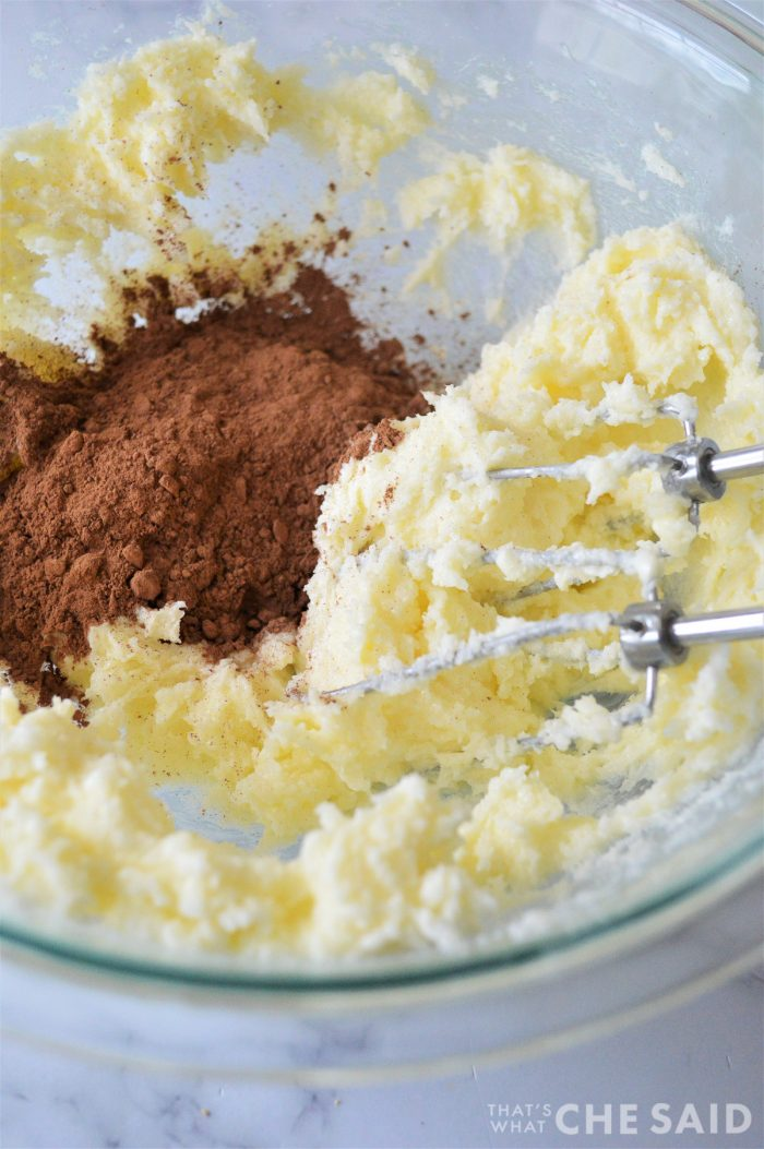 Clear Mixing Bowl with creamed butter and sugar and cocoa powder
