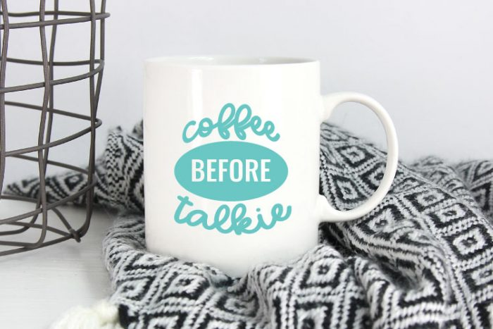 Black and White Blanket with White Mug and Coffee Before Talkie applied in aqua adhesive vinyl - Horizontal Orientation