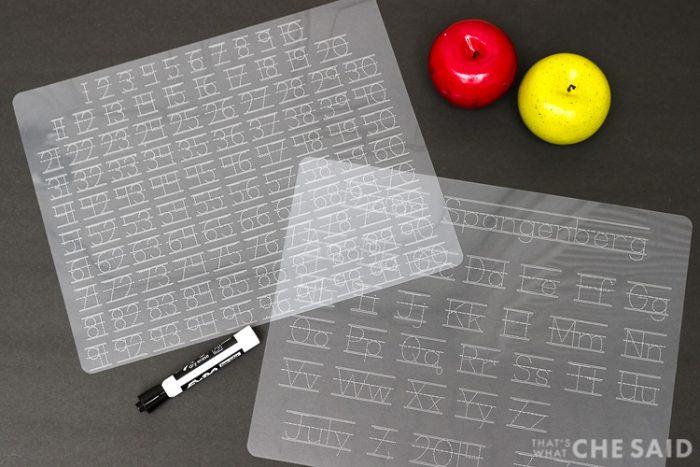 "Dollar store plastic cutting mats turned Alpha and Numeric tracing mats using a Cricut Machine - Horizontal shot both mats on black ""chalkboard"" background"