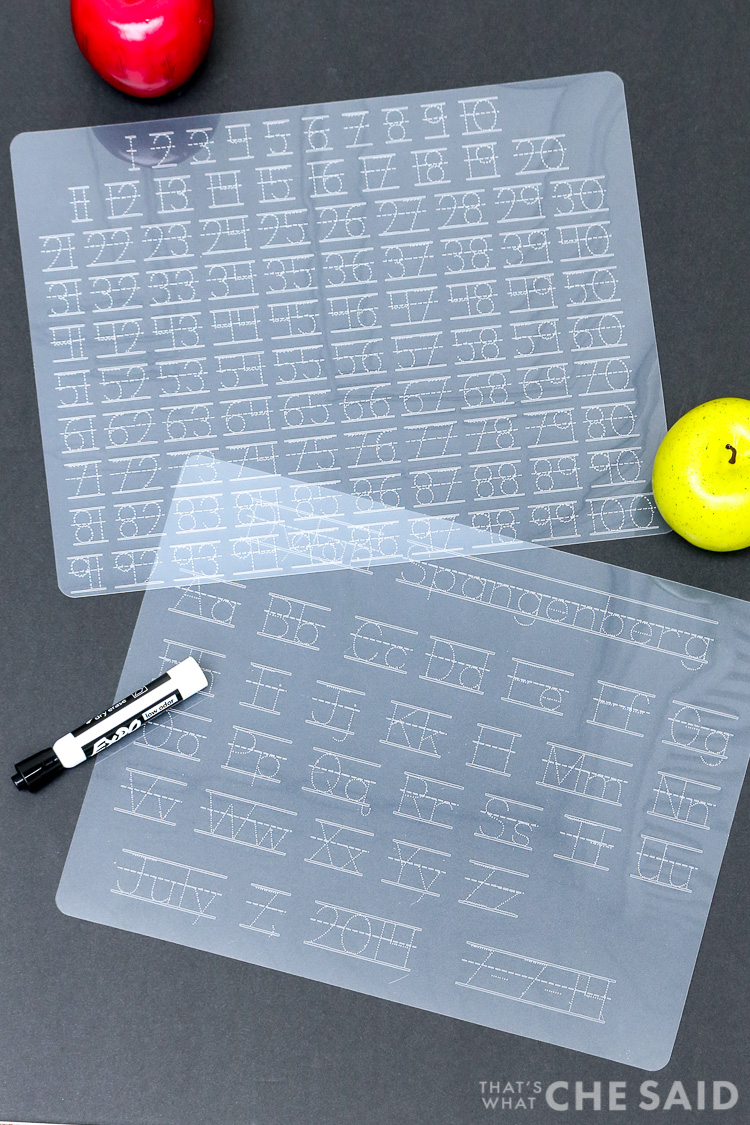 "Dollar store plastic cutting mats turned Alpha and Numeric tracing mats using a Cricut Machine - Vertical shot both mats on black ""chalkboard"" background"
