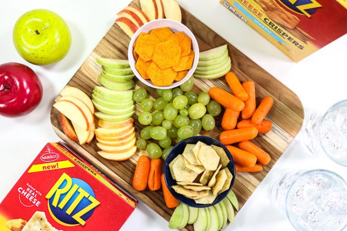 Overhead shot of board filled with fruit, veggies and Ritz Cheese Crispers