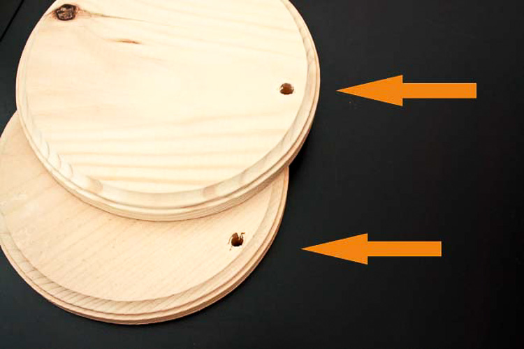 Drill holes in the circle wooden discs