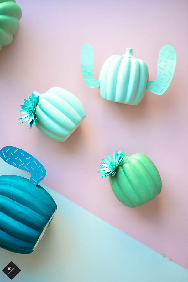 Pumpkins turned into cacti with paper arms and flowers and adhesive vinly prickles