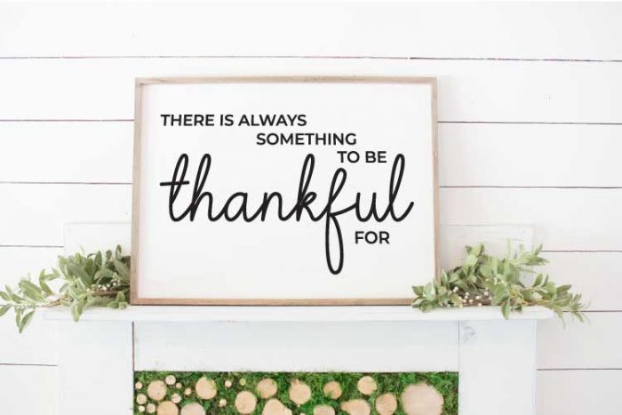 "White Mantel with large sign that reads ""There is Always Something to Be Thankful For"" in vinyl - vertical"