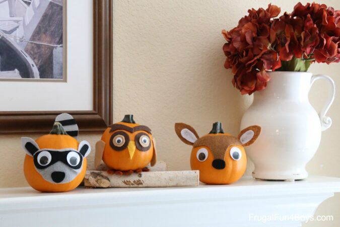 Small pumkins with felt accents to resemble woodland creatures