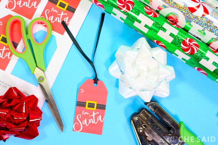 Adding a ribbon to the From Santa Gift Tag