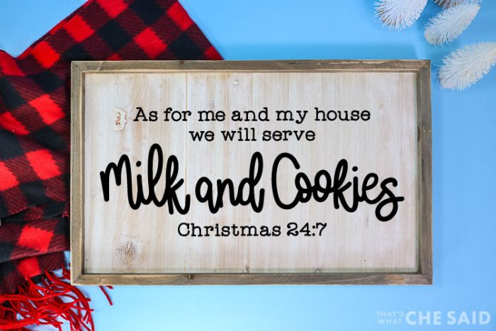 Blue background with red and black buffalo check scarf and bottle brushes in background.  Sign with Milk & Cookies SVG on a wooden sign in horizontal format