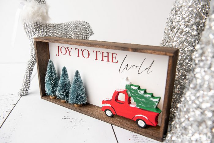 DIY Christmas Sign with Silver trees and deer in background - horizontal