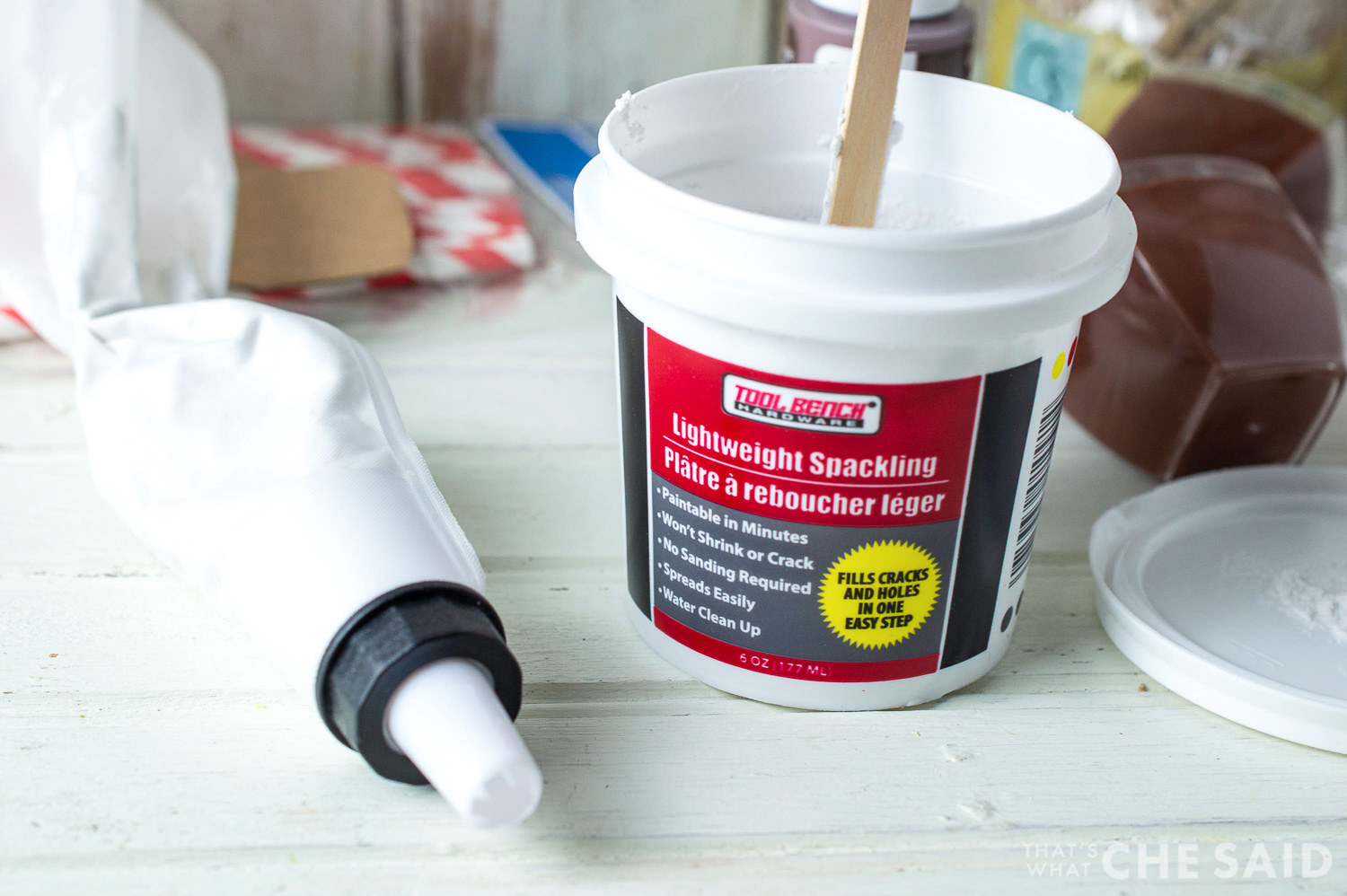 Dollar store spackle container and piping bag filled with it