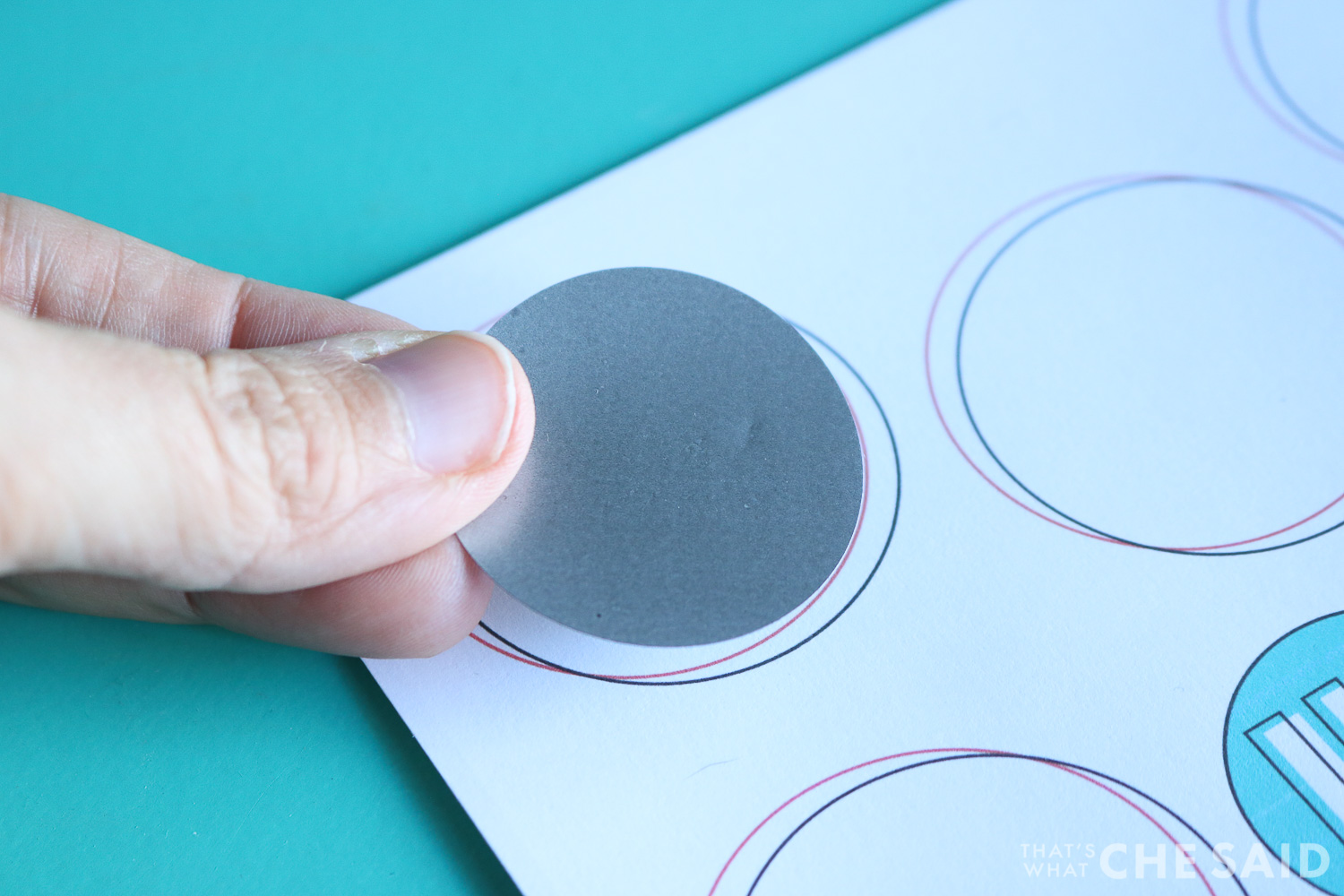 Placing the scratch off sticker on the printable