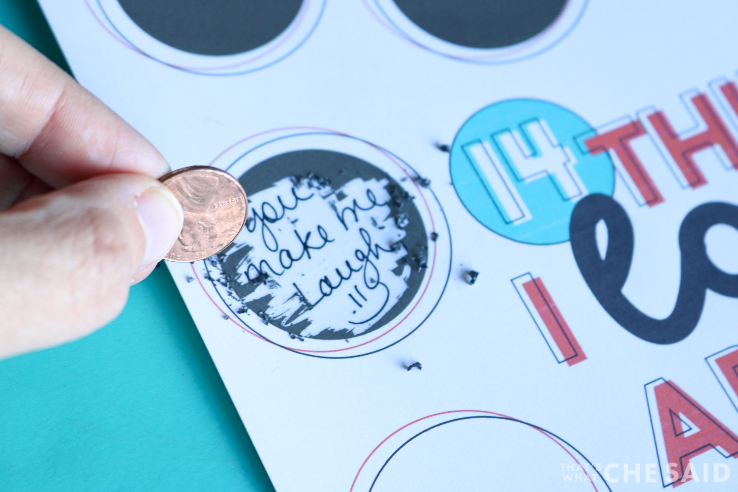 Close up of scratch off sticker being scratched off with a penny
