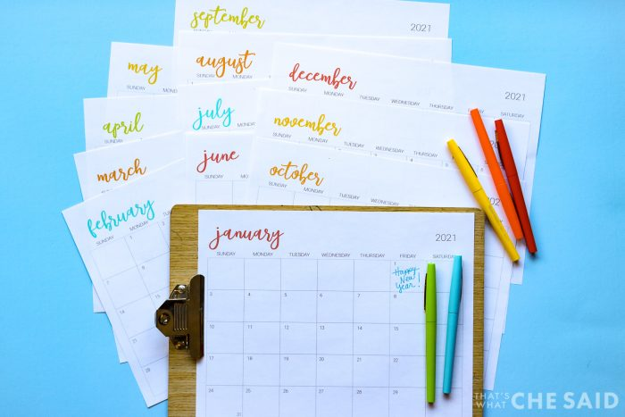 Blue background with printable calendar sheets and felt tip pens