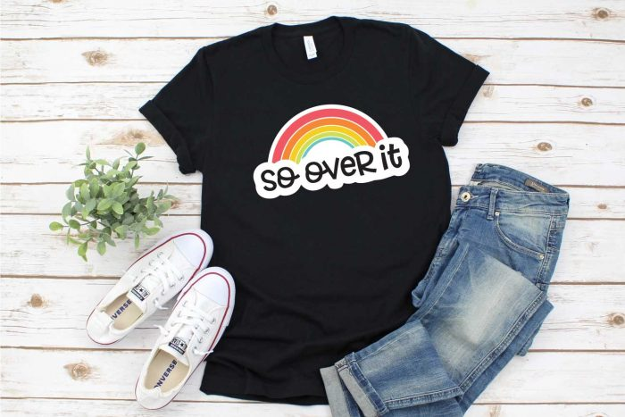 Black Tshirt with rainbow design, jeans and tennis shoes - horizontal shot