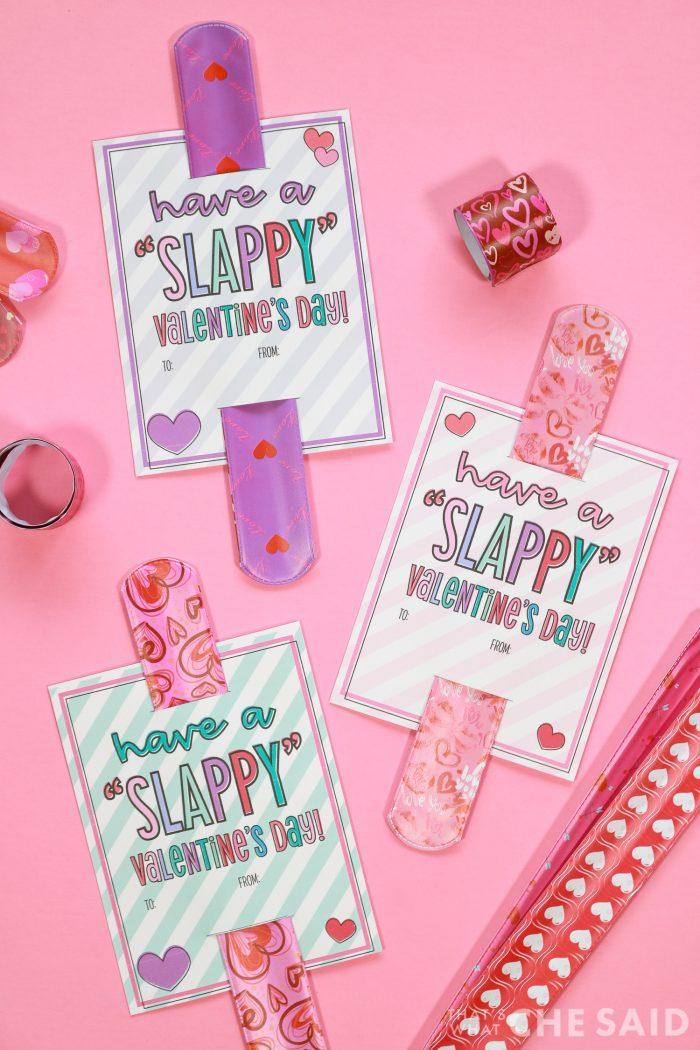 Free printable slap bracelet valentines on pink background with slap braclets